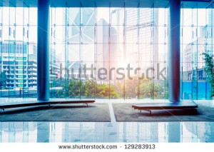 stock-photo-glass-wall-in-the-office-building-129283913