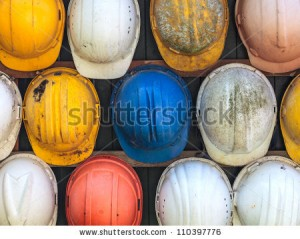 stock-photo-old-and-worn-colorful-construction-helmets-110397776
