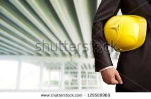 stock-photo-worker-or-engineer-holding-in-hands-yellow-helmet-for-workers-security-on-the-background-of-a-new-129588968