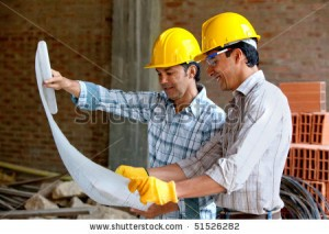 stock-photo-architects-at-a-construction-site-looking-at-blueprints-51526282