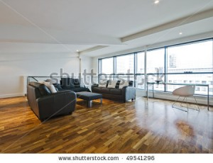 stock-photo-living-room-of-a-penthouse-placed-in-loft-49541296