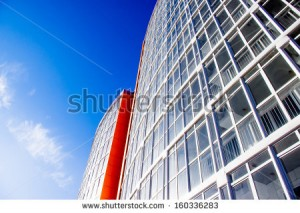 stock-photo-new-building-with-a-glass-facade-against-the-sky-view-from-below-160336283